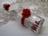 pozivnica u boci sa crvenom spužvastom ružom