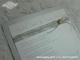 srebrna pozivnica sa školjkom