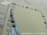 zahvalnica s plavim tiskom morskih zvijezda i školjki